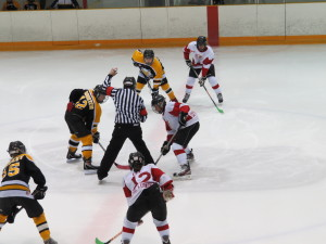 Face off! The first game of the PMHA Winter Classic Thursday night at the Barn.  Iroquois Falls DeLaplante Insurance and the Schumacker Lions treated fans to an exciting game.